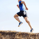 male runner running on mountain trail - PhotoDune Item for Sale
