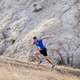 sporty man running uphill - PhotoDune Item for Sale
