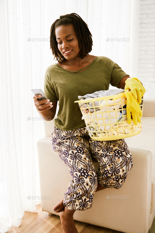Texting housewife - Stock Photo - Images