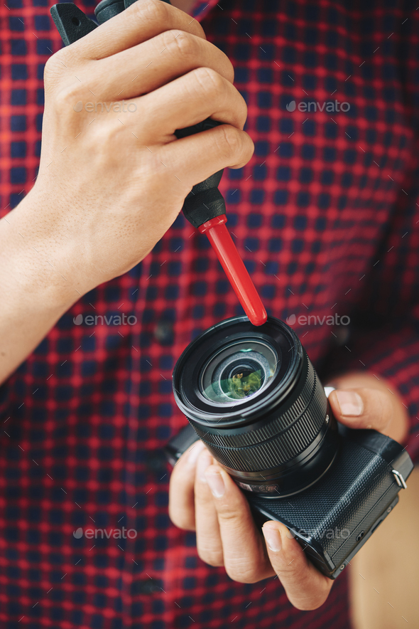 Cleaning lens - Stock Photo - Images