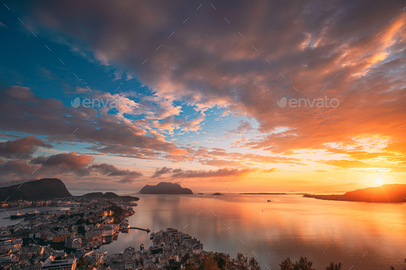 Alesund, Norway. Amazing Natural Bright Sunset Dramatic Sky In W - Stock Photo - Images