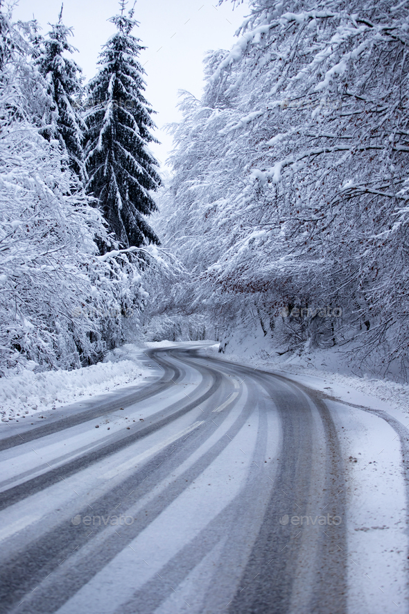 Empty road with snow banks on sides. - Stock Photo - Images
