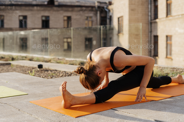 Young girl practicing stretching and yoga workout exercise - Stock Photo - Images
