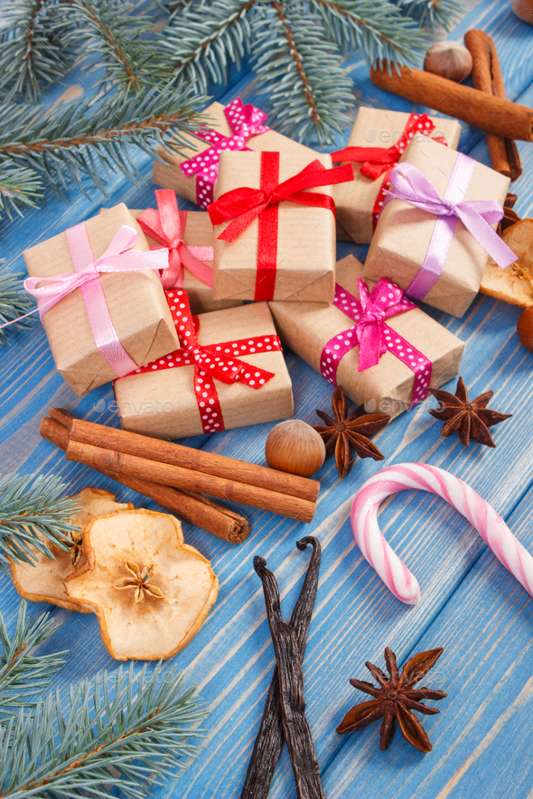 Wrapped gifts with ribbons for Christmas, spices and spruce branches - Stock Photo - Images