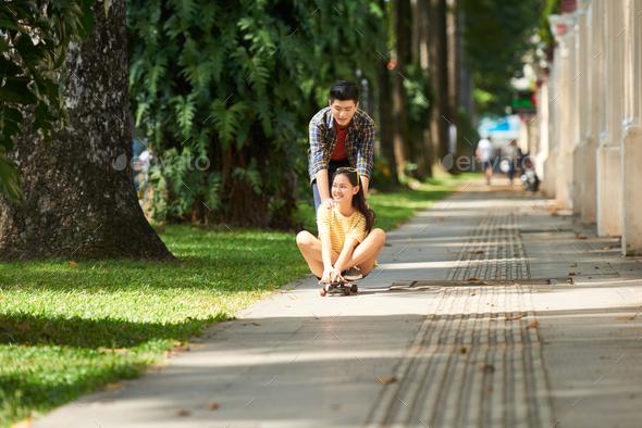 Couple riding on skateboard - Stock Photo - Images