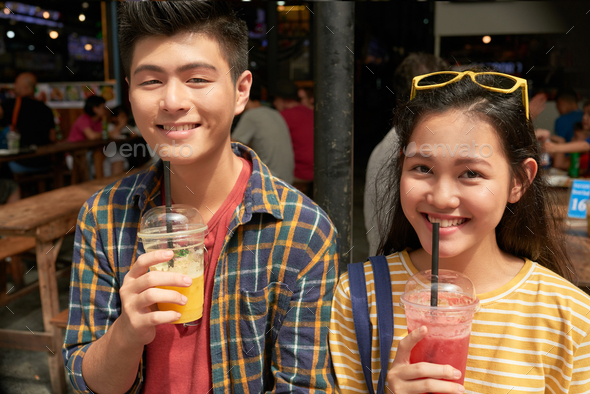 Couple drinking cocktails - Stock Photo - Images
