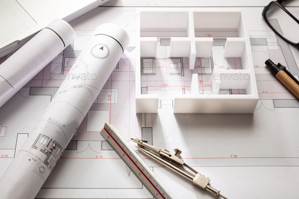 Construction concept. Residential building drawings and house model, - Stock Photo - Images