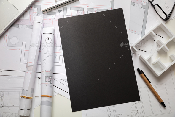 Construction concept. Residential building blueprint drawings and office supplies - Stock Photo - Images