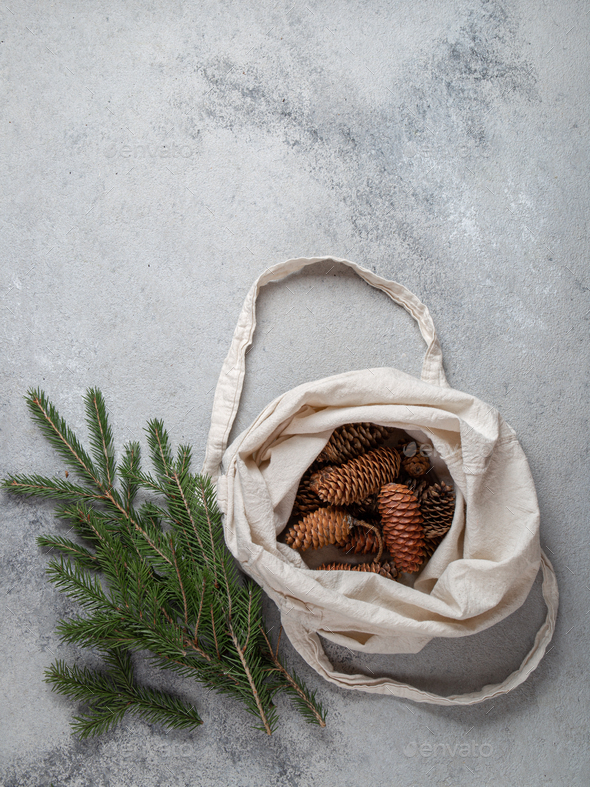 Zero waste Christmas concept. Natural Chirsmas decoration, pine cones and branches in linen bag. - Stock Photo - Images