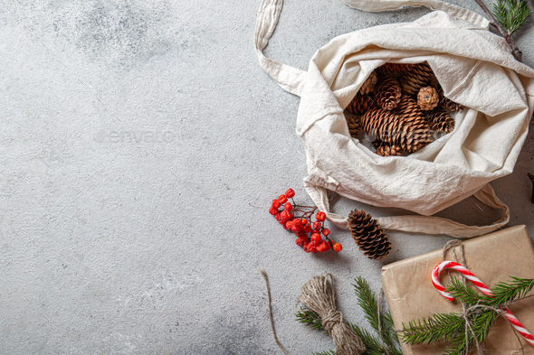 Zero waste Christmas concept. Natural Chirsmas decoration, pine cones and branches in linen bag - Stock Photo - Images