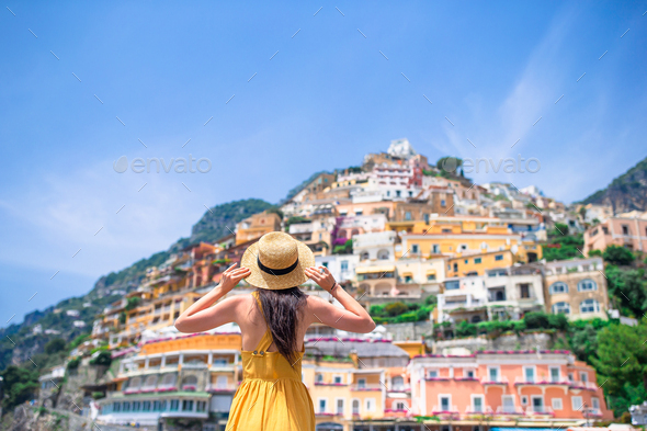 Summer holiday in Italy. Young woman in Positano village on the background, Amalfi Coast, Italy - Stock Photo - Images