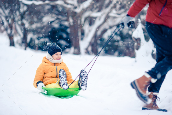 Family of dad and kids vacation on Christmas eve outdoors - Stock Photo - Images
