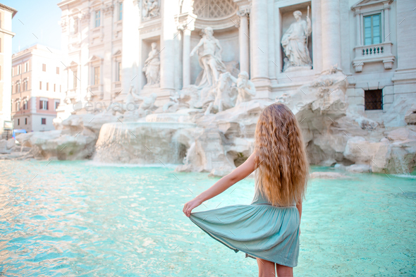 Adorable little girl background Trevi Fountain, Rome, Italy - Stock Photo - Images
