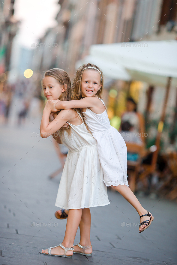 Pretty smiling little girls with shopping bags - Stock Photo - Images