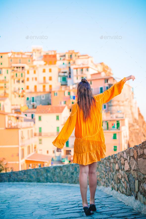 Tourist looking at scenic view of Manarola, Cinque Terre, Liguria, Italy - Stock Photo - Images