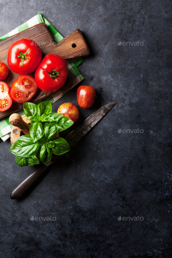 Fresh ripe garden tomatoes and basil on stone table - Stock Photo - Images
