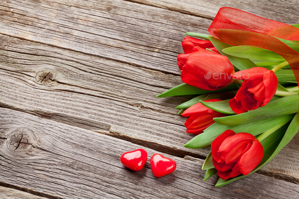 Red tulips and Valentine's day candy hearts - Stock Photo - Images