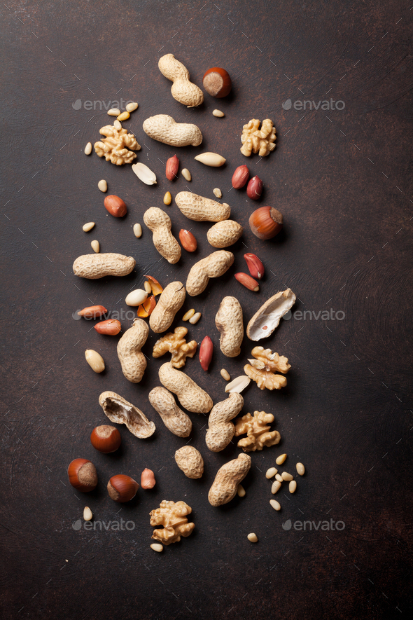 Various nuts on stone table - Stock Photo - Images