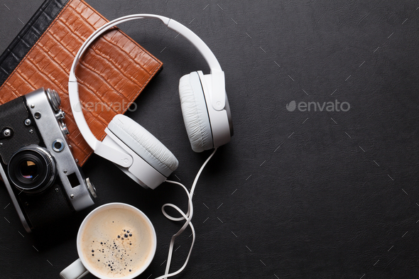 Office leather desk table with headphones, camera and coffee - Stock Photo - Images