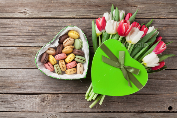 Colorful tulips bouquet and macaroons - Stock Photo - Images