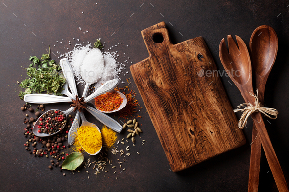 Various spices spoons on stone table - Stock Photo - Images