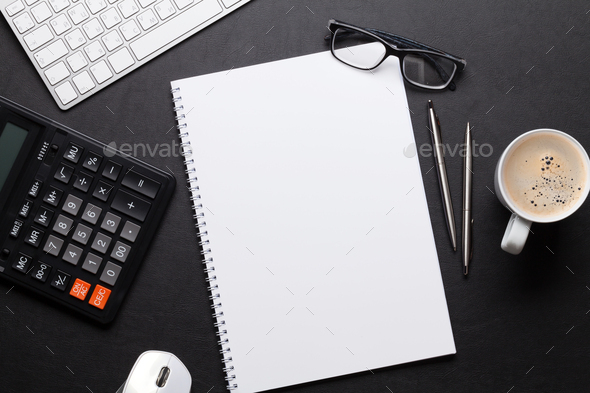 Office desk table with pc, notepad, glasses, coffee - Stock Photo - Images