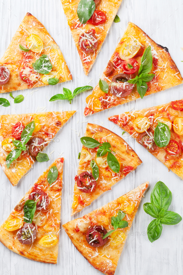 Pizza with tomatoes, mozzarella and basil - Stock Photo - Images