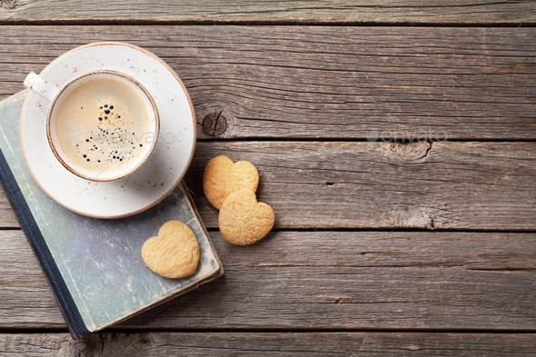 Coffee cup and heart shaped cookies - Stock Photo - Images