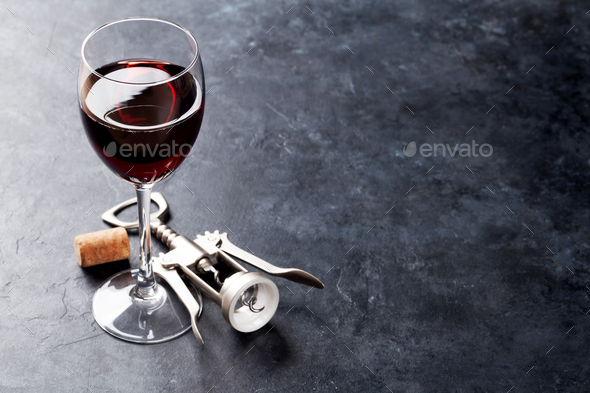 Red wine glass and corkscrew - Stock Photo - Images