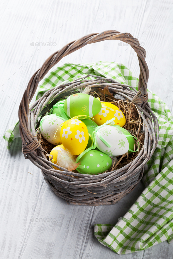 Colorful easter eggs in basket - Stock Photo - Images