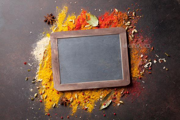 Chalkboard for your text over various spices - Stock Photo - Images