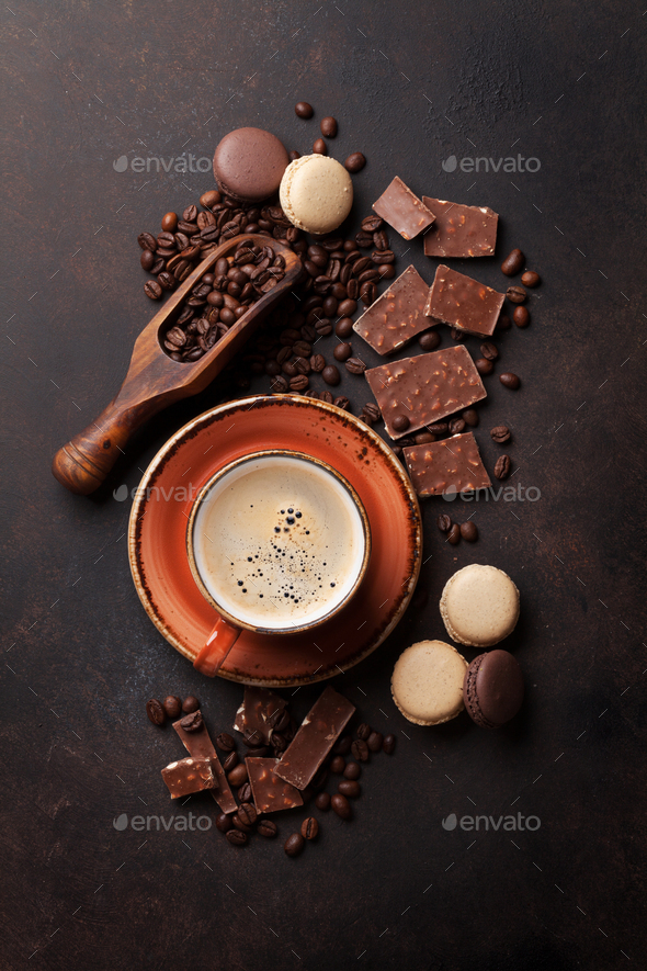 Coffee cup, chocolate and macaroons on old kitchen table - Stock Photo - Images