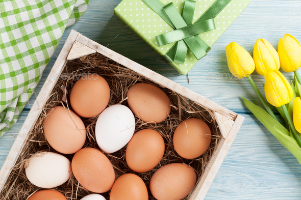 Easter eggs and yellow tulips - Stock Photo - Images