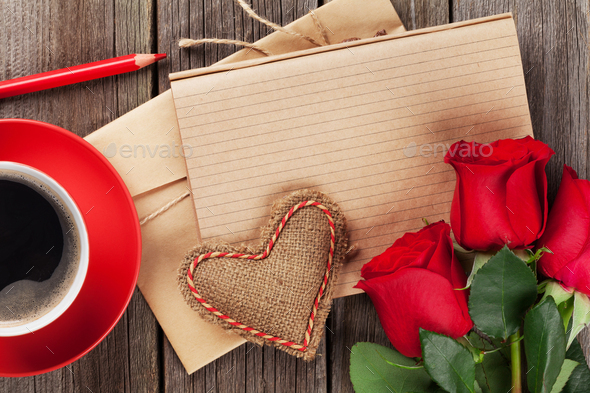 Love letter notepad, red roses and coffee cup - Stock Photo - Images
