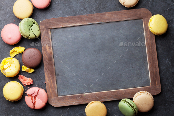 Colorful macaroons and blackboard - Stock Photo - Images