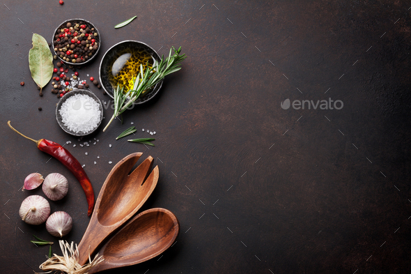 Cooking table with herbs, spices and utensils - Stock Photo - Images
