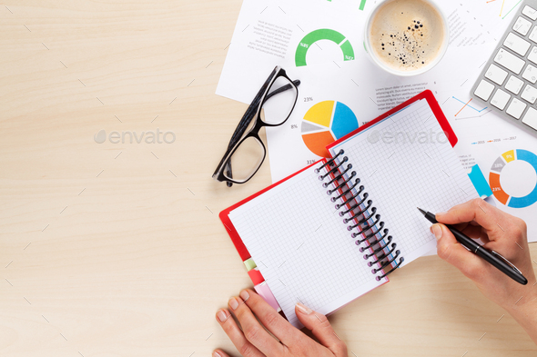 Woman working with reports and charts - Stock Photo - Images