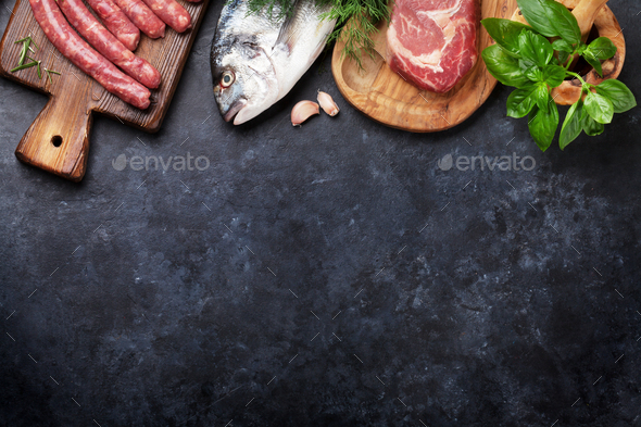 Sausages, fish and meat cooking - Stock Photo - Images