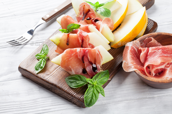 Fresh melon with prosciutto and basil - Stock Photo - Images