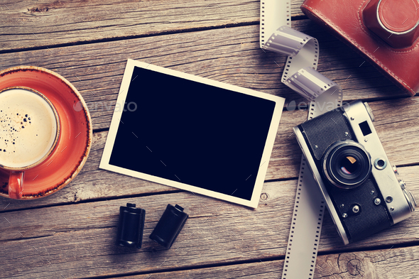 Vintage camera and blank photo frame - Stock Photo - Images