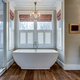 High end bathroom with large white bathtub and shiplap siding. - PhotoDune Item for Sale