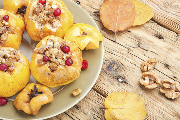 Baked quince stuffed with nuts - Stock Photo - Images