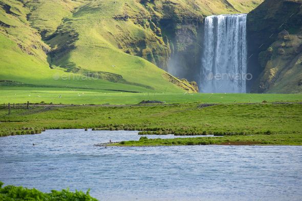 Skogafoss waterfall, on the Ring Road in Iceland - Stock Photo - Images