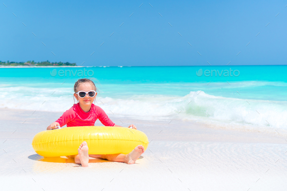 Adorable little girl having fun on the beach - Stock Photo - Images