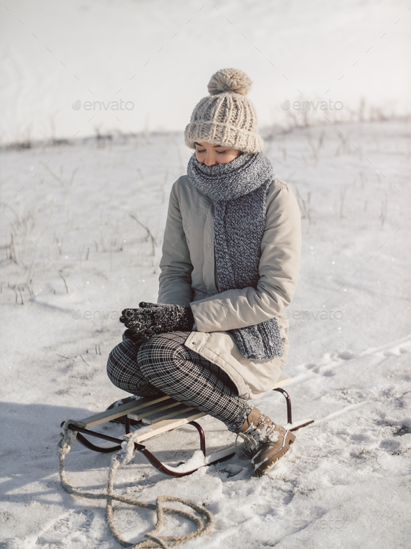Woman with Sled Outdoors - Stock Photo - Images