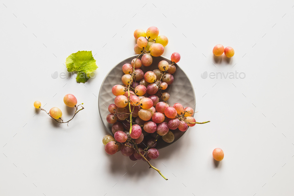 Isolated grapes. Red grape in a bowl isolated on white background - Stock Photo - Images