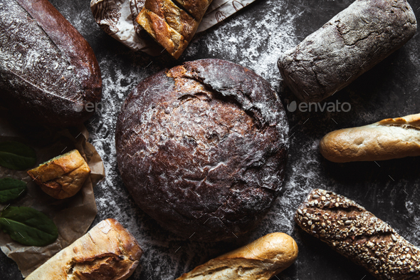 Different types of bread on black background - Stock Photo - Images