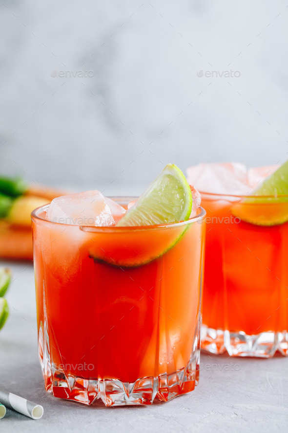 Carrot Ginger Margarita cocktail with lime in glass - Stock Photo - Images