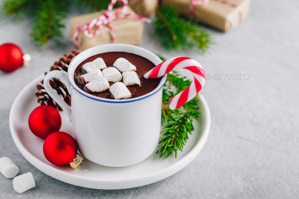 Festive Christmas Hot Chocolate with marshmallow and candy cane - Stock Photo - Images