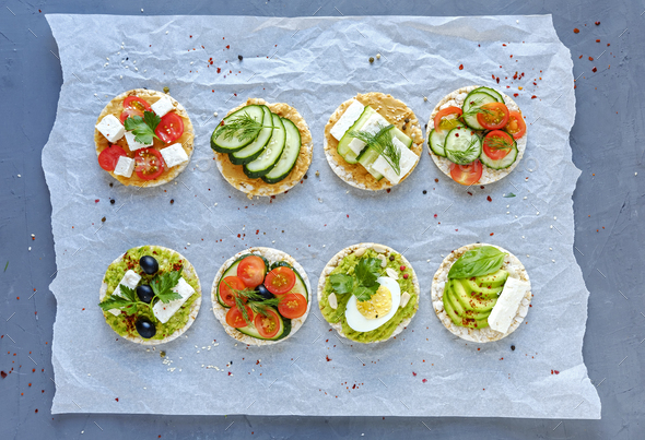 Assorted tasty appetizers with fresh vegetables - Stock Photo - Images
